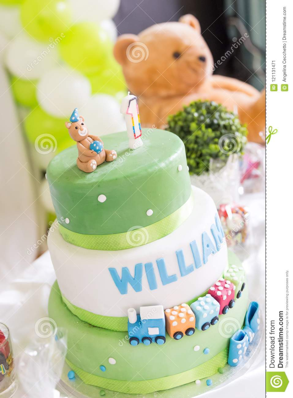 Green And White Birthday Cake With One Year Old Candle Teddy