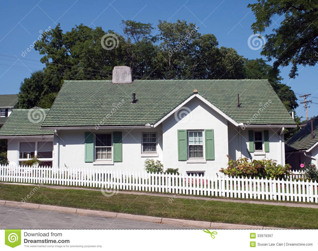 Green & White Cottage With White Picket Fence Royalty Free