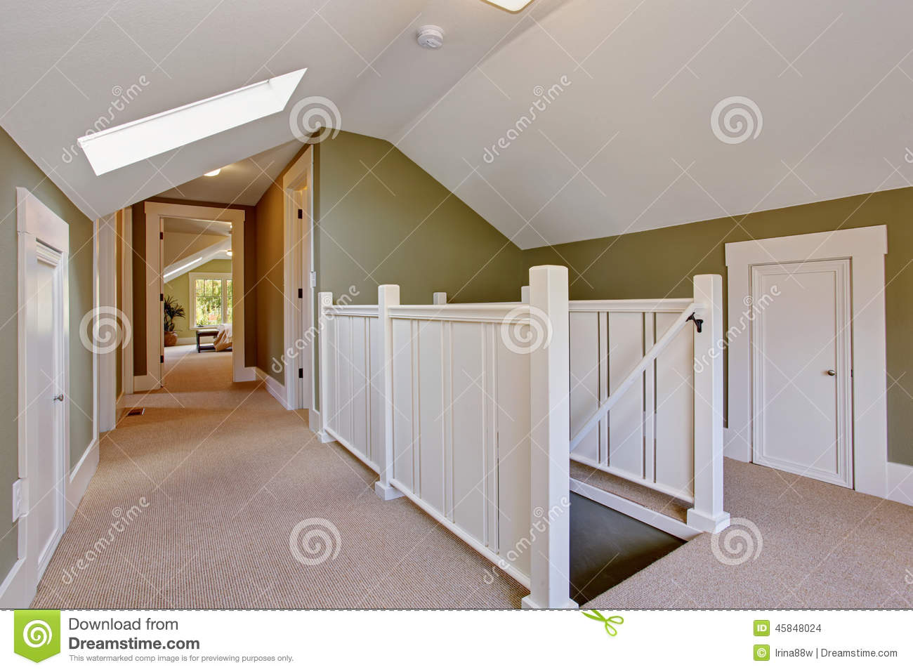 Green And White Upstairs Hallway With Vaulted Ceiling And