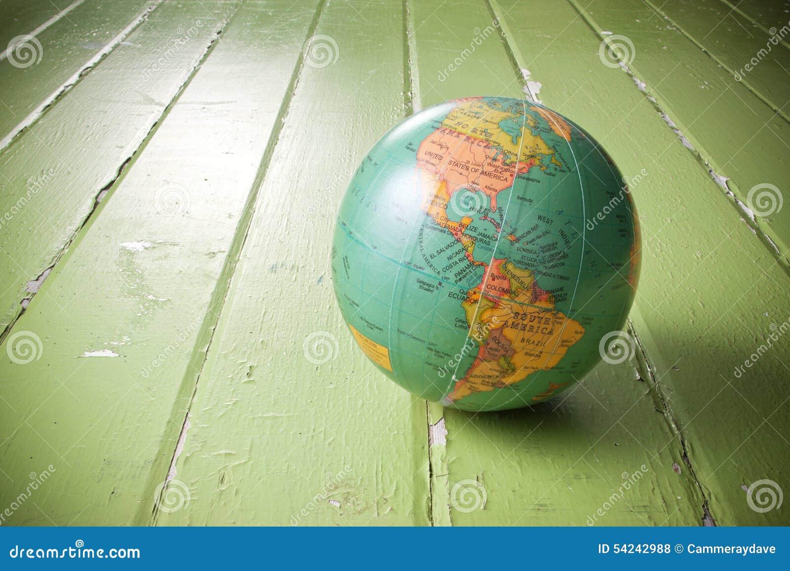 A World Globe On Rustic Green Background