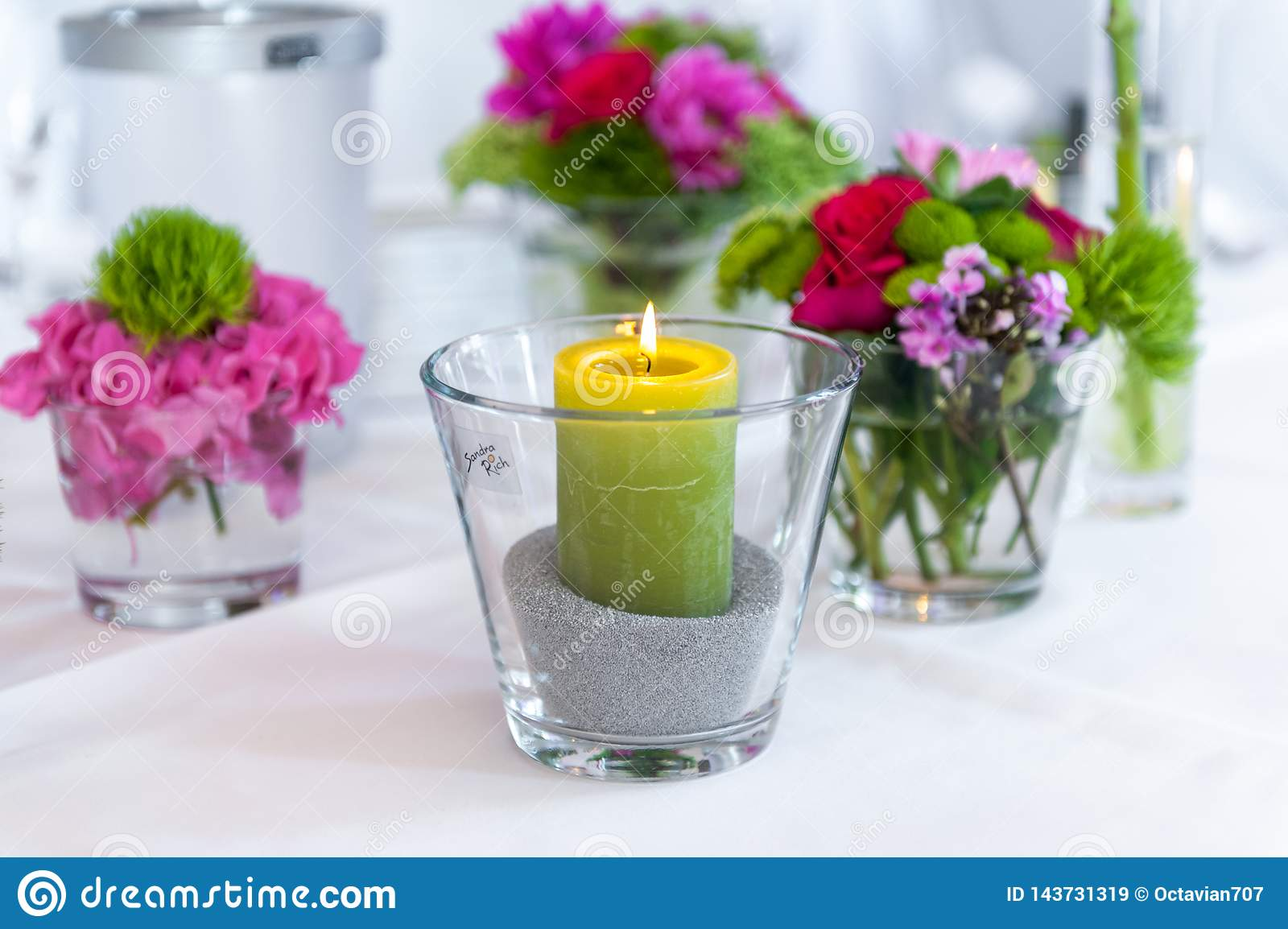 Candle in glass on white table