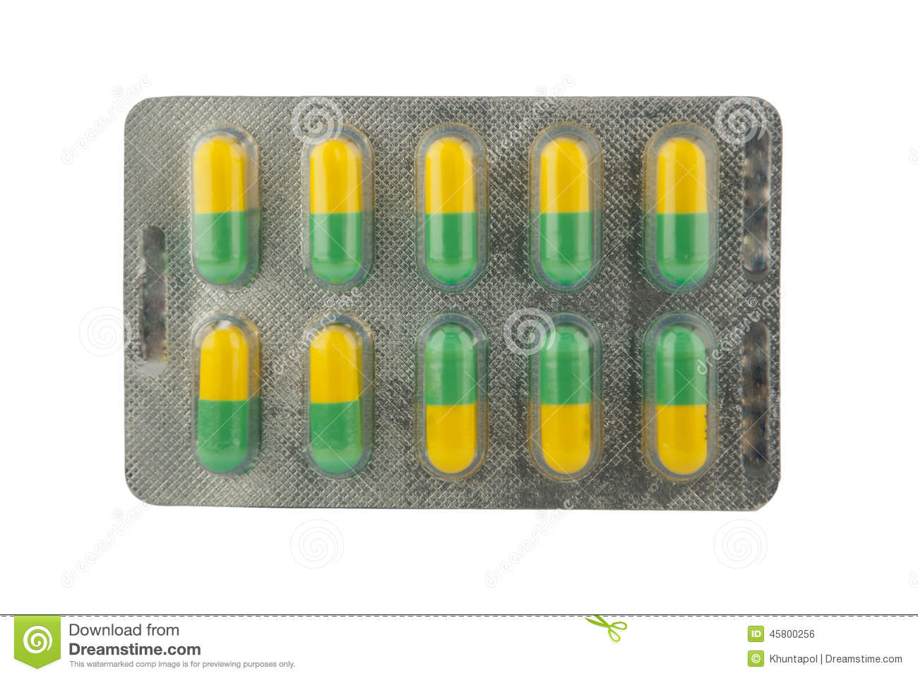 Green And Yellow Capsule In Blister Pack Stock Photo