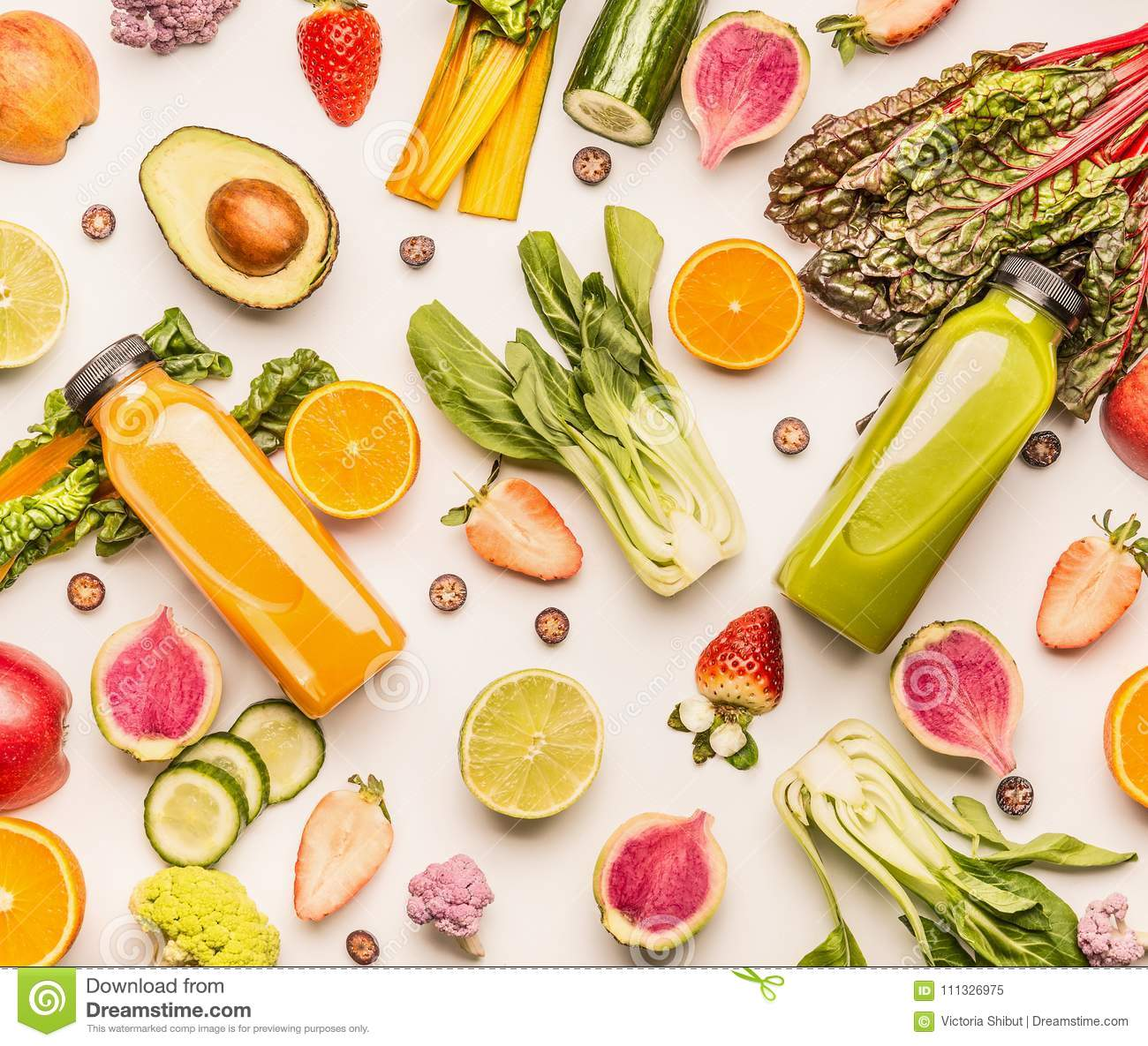 Green and yellow smoothie bottles with organic fruits and vegetables ingredients: kale, avocado,cucumber, orange, strawberries, bl