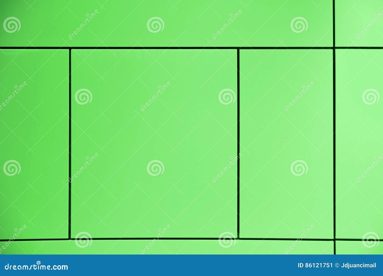 Greenfield Zielony tło krzyżujący liniami tworzy kwadraty i prostokąty w abstrakcjonistycznej architektonicznej ścianie