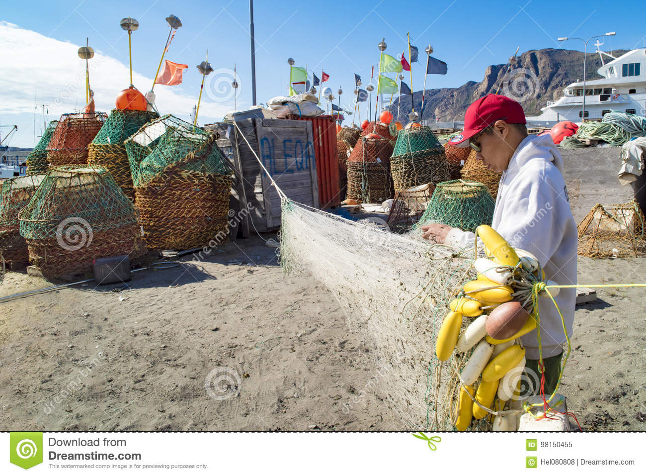 Greenlandic Fisherman preparing nets