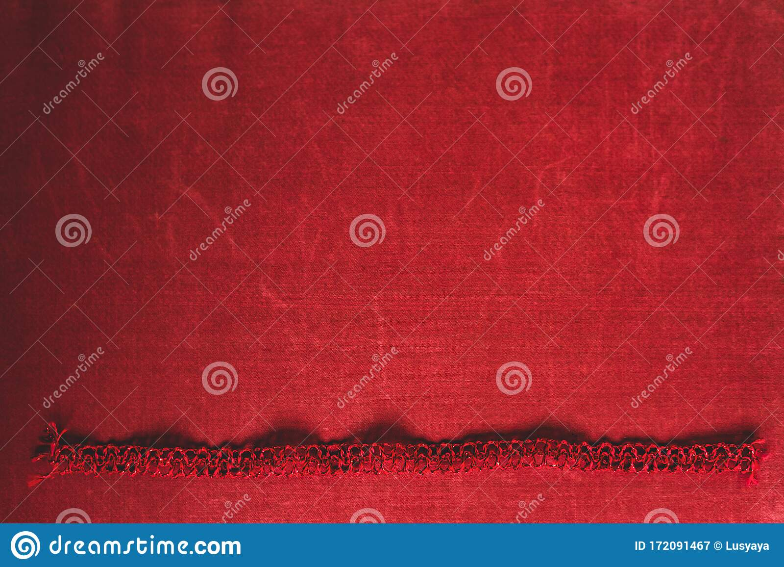 greeting card on old red textile border fabric backgrounds