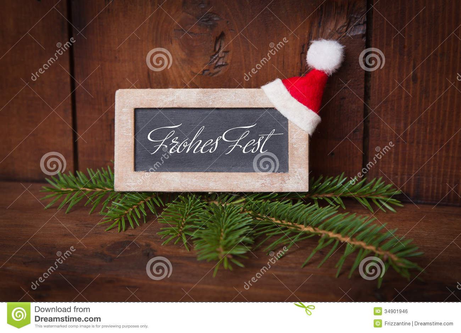 Greeting Happy Holiday On Chalkboard With Santa Hat In German La