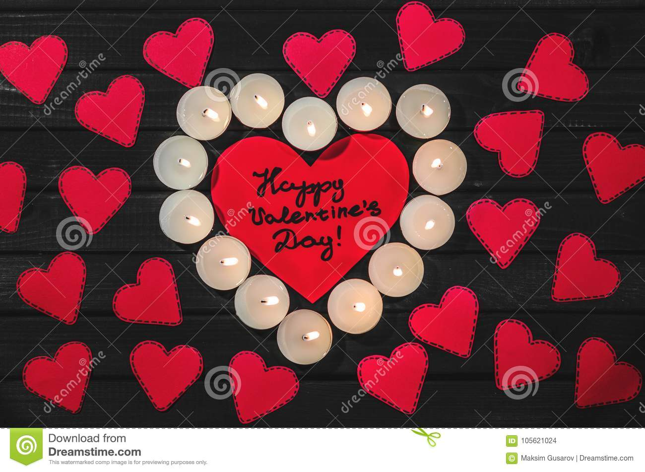 Greetings with valentines day on a red paper heart surrounded by greetings with valentines day on a red paper heart surrounded by hearts and candles m4hsunfo