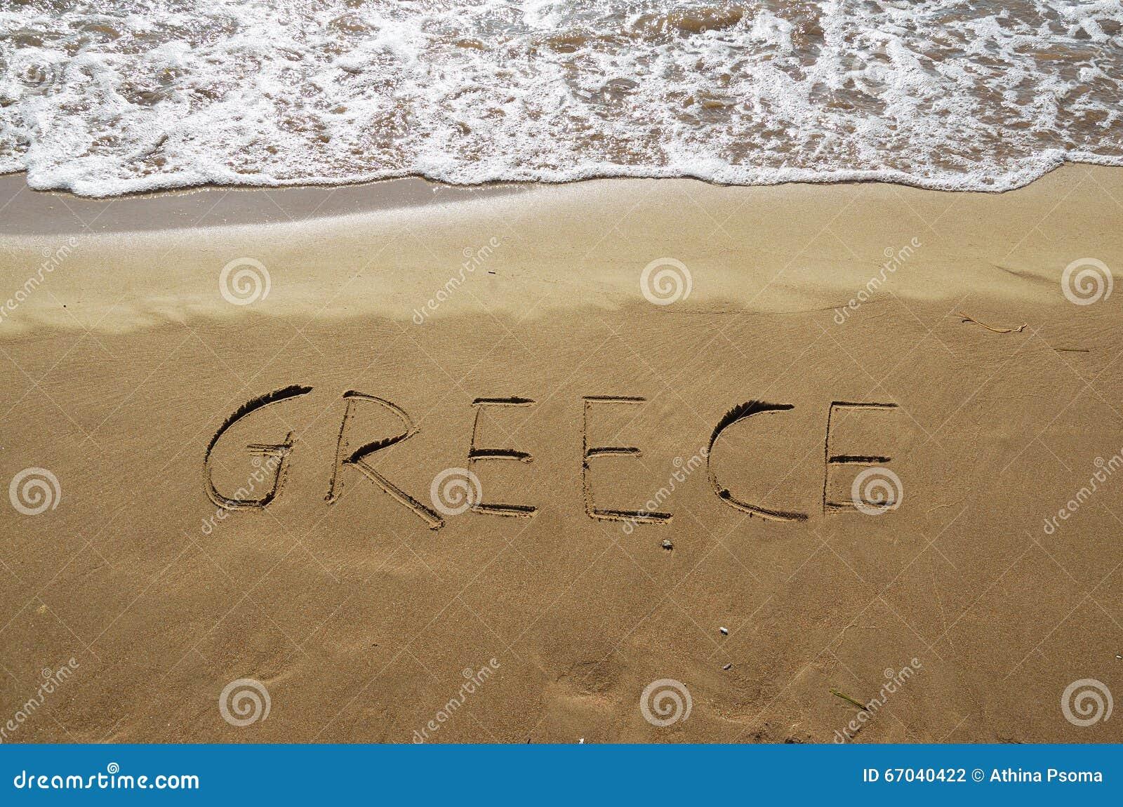 Grekland som är skriftlig i sand
