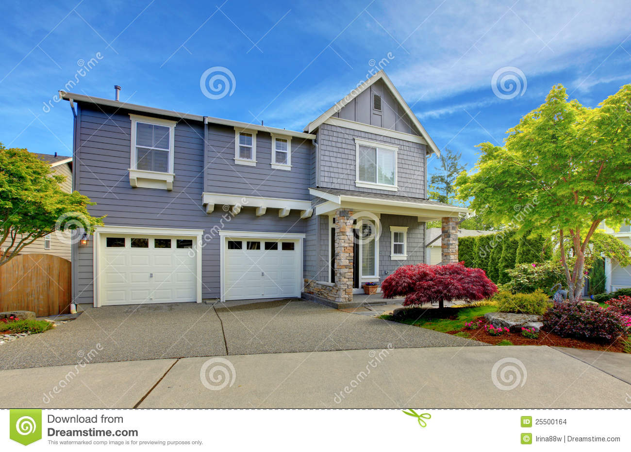 Grey American House With Two Garage Doors Stock Photo