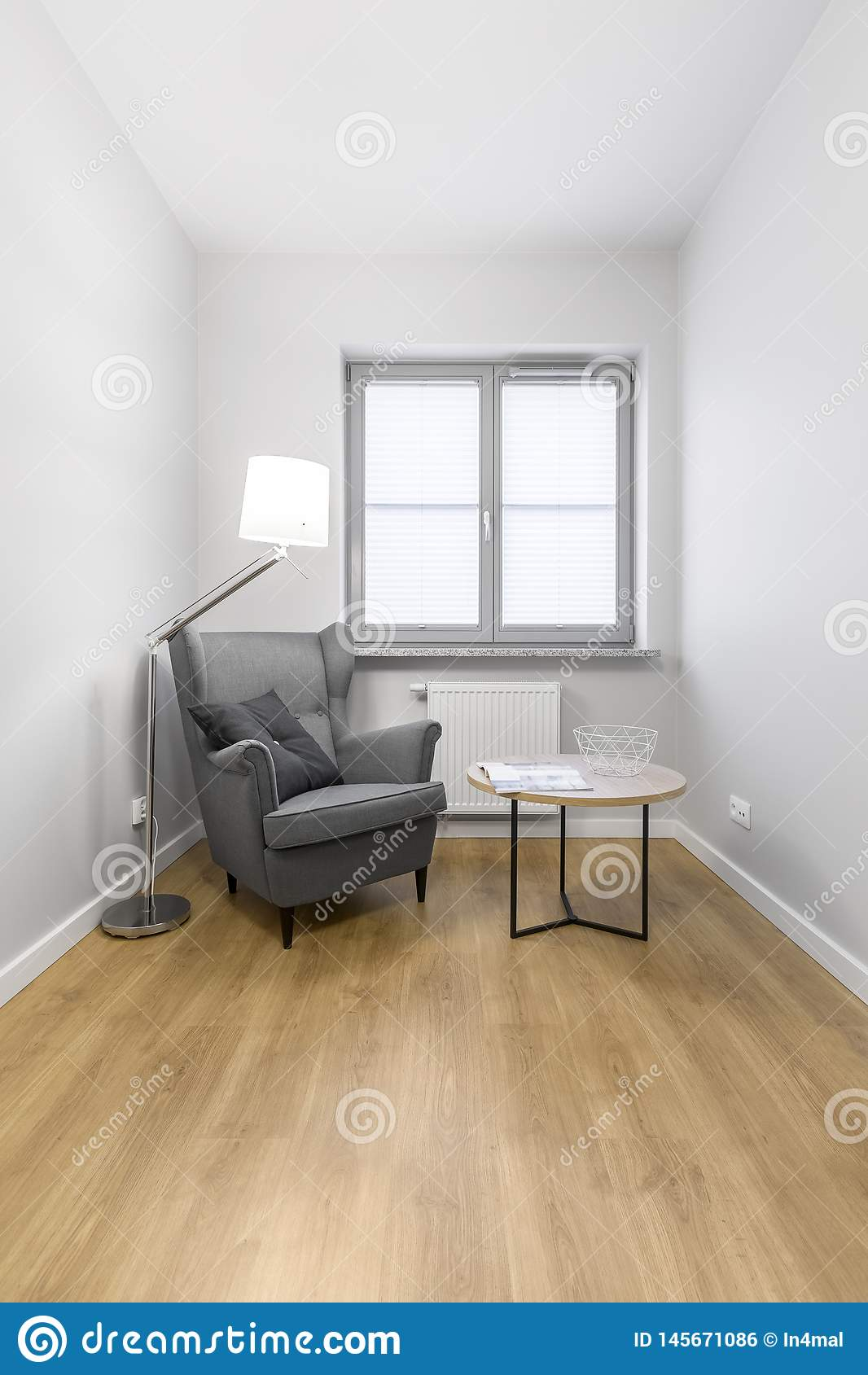 Grey Armchair With Small Table Stock Photo - Image of ...
