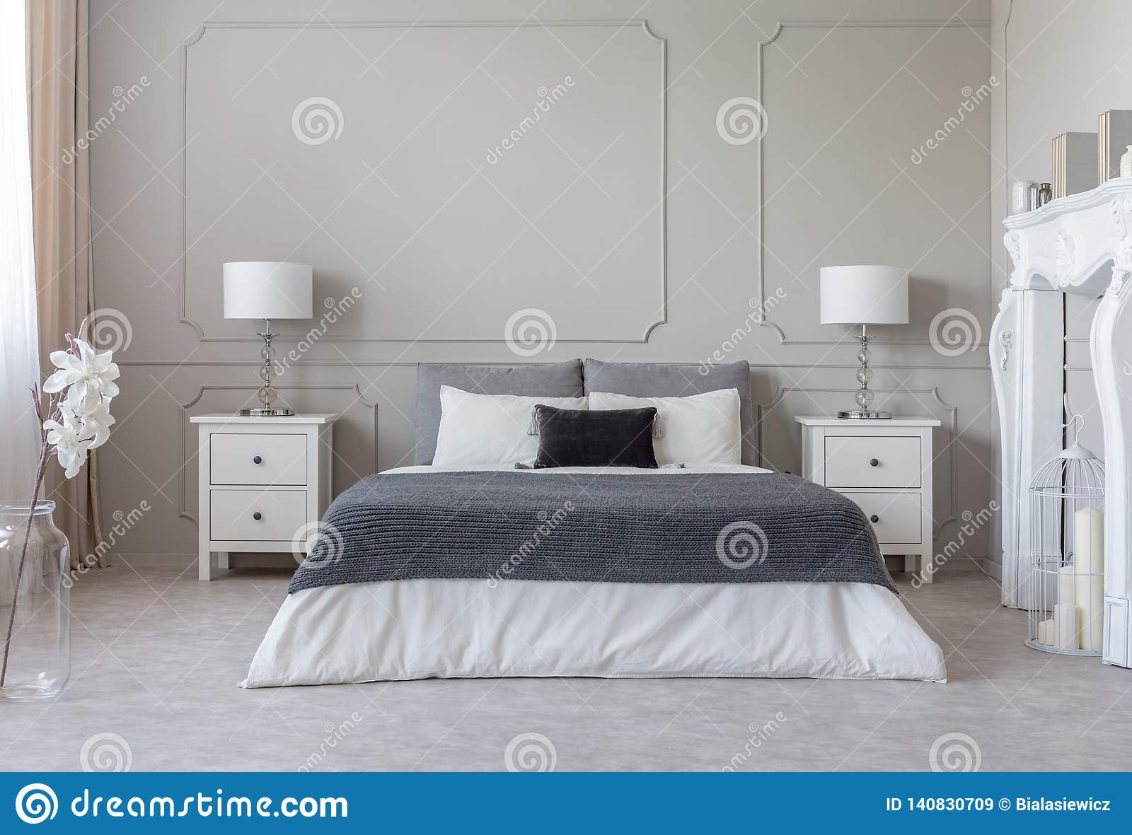 Grey Blanket On White Bedding On Comfortable King Size Bed