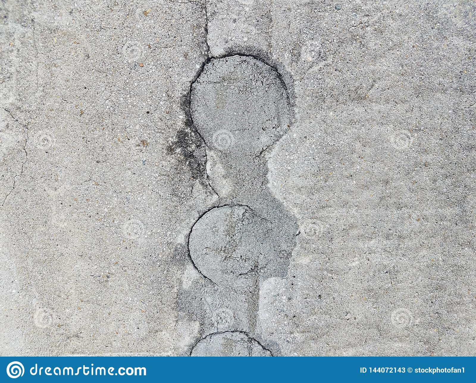 Grey cement wall with circular hole filled