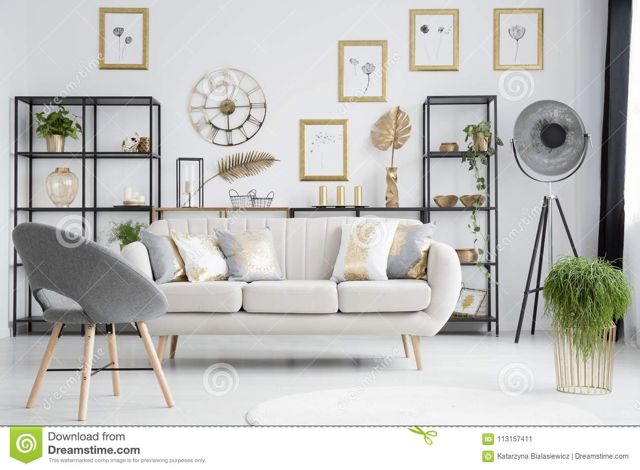Grey and gold living room stock image. Image of monochromatic ...