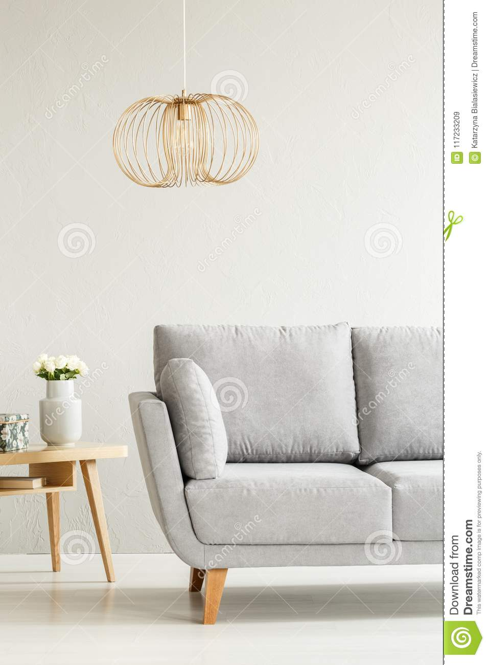 Grey and gold living room stock image. Image of settee - 117233209
