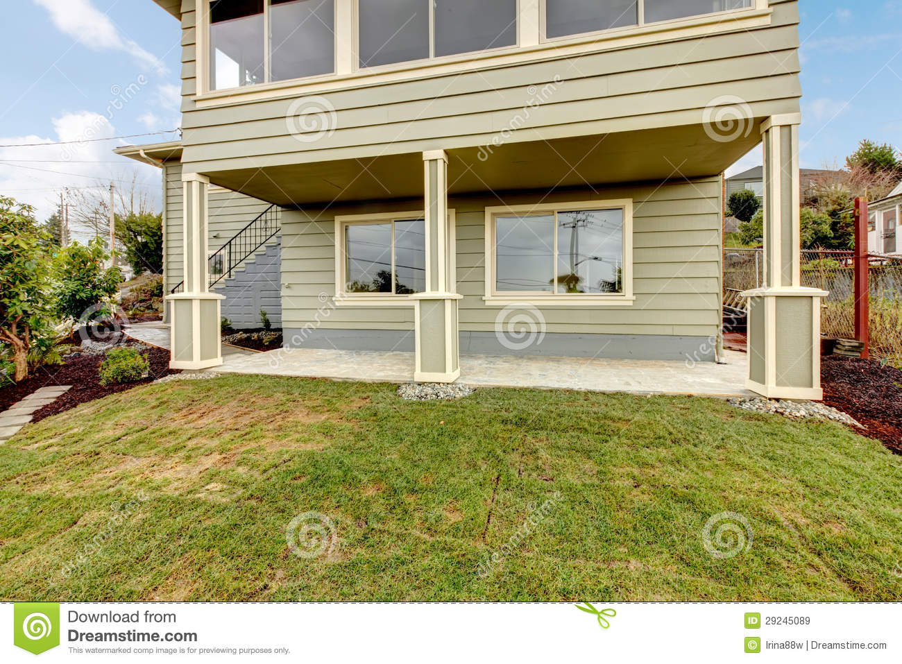 Grey Green Newly Remodeled Two Level House Exterior Stock