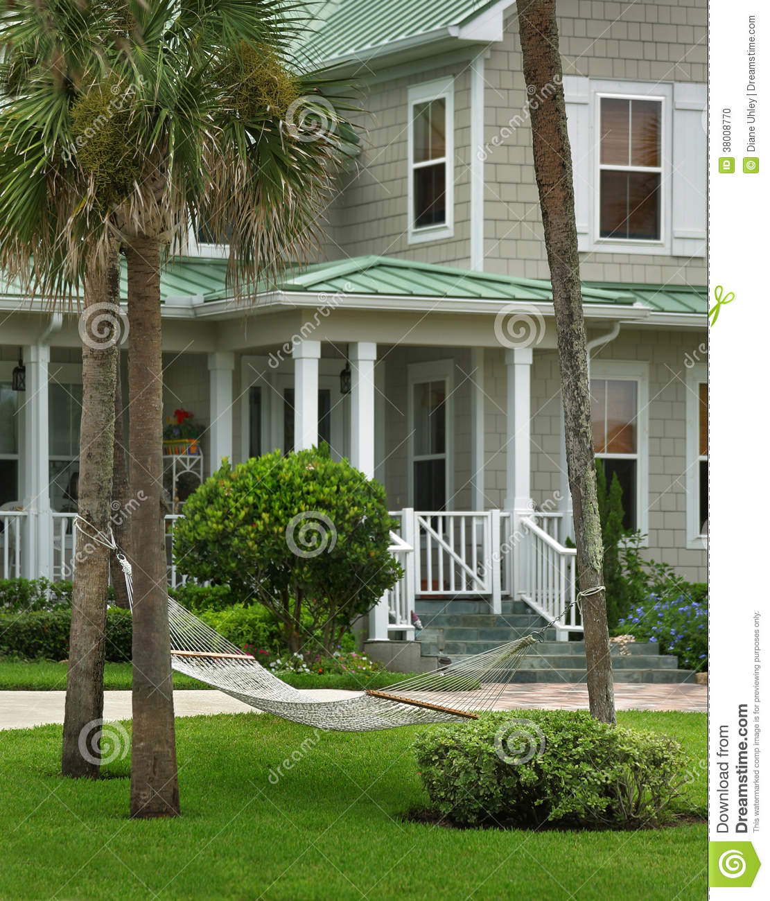 grey house with green roof stock photo image 38008770
