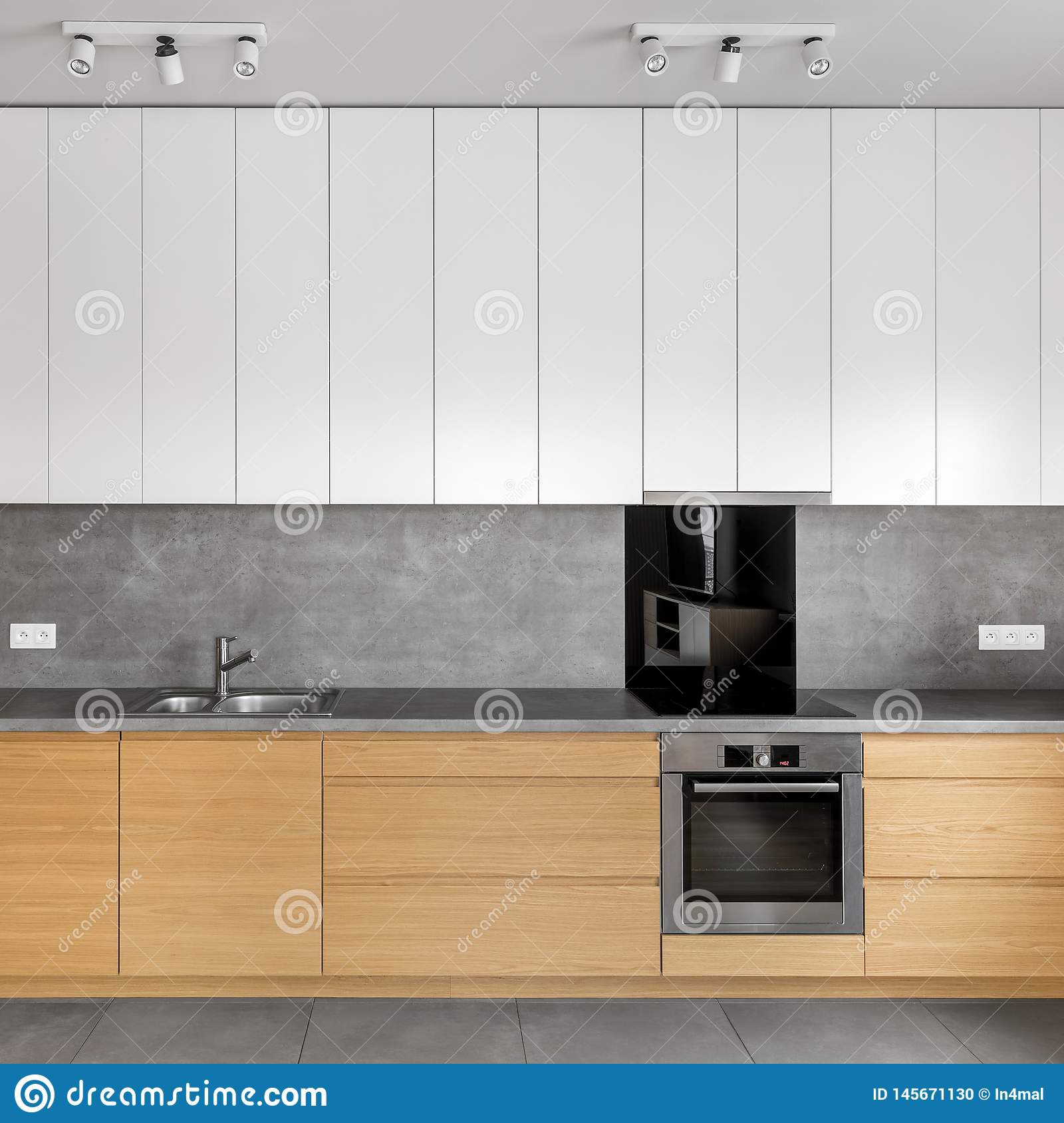 Grey Kitchen With Wooden Cabinets Stock Photo Image Of Contemporary Light 145671130
