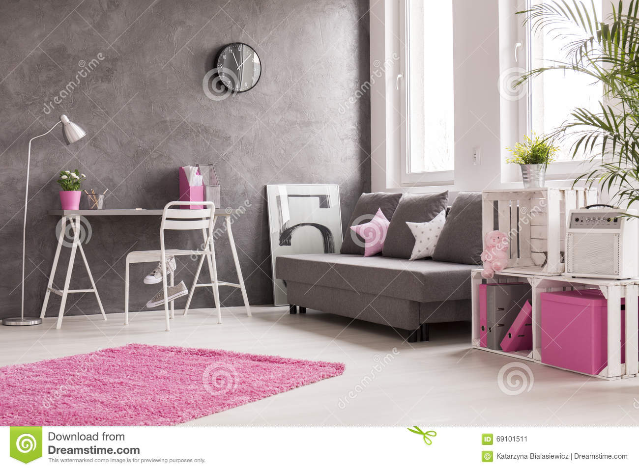 Grey living room with pink and white details stock photo Pink room with white furniture