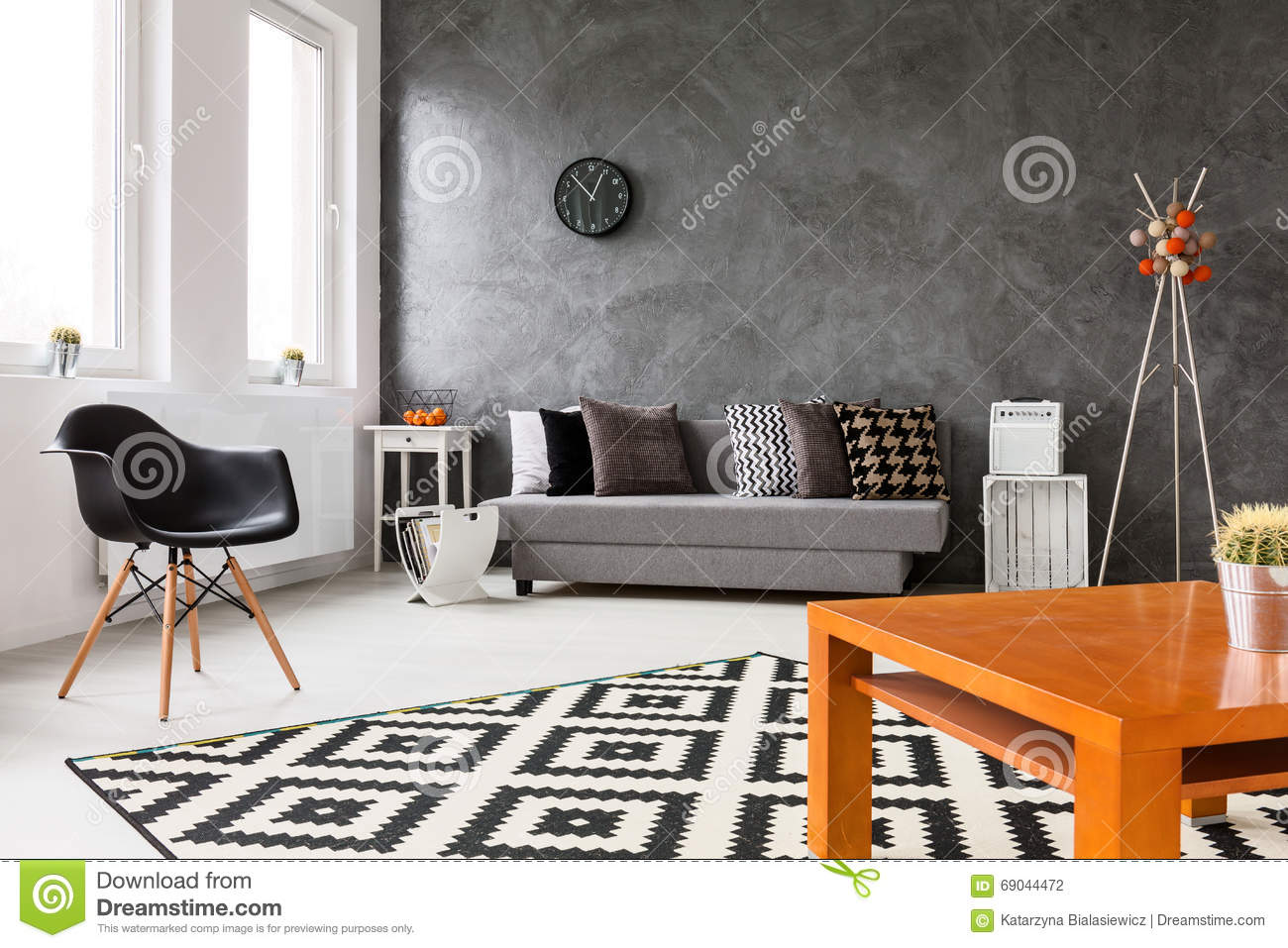 Grey living room with trendy home decorations stock photo for Trendy home decorations