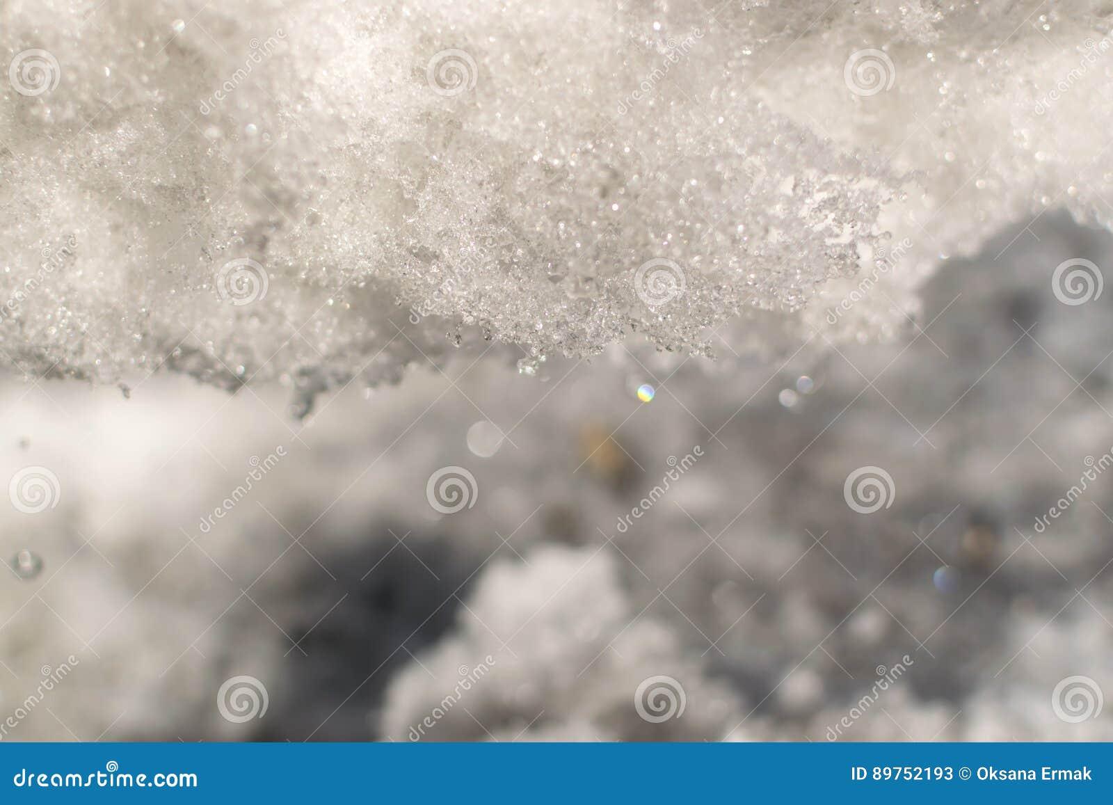 Grey Melted Snow på jordningen i tidig vår