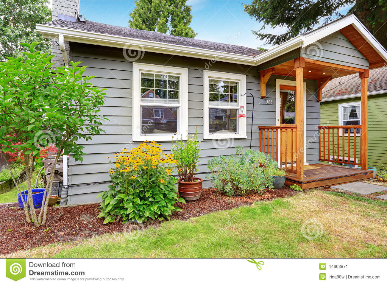 Grey old house with wooden trim stock photo image 44603871 for Small flower beds front homes