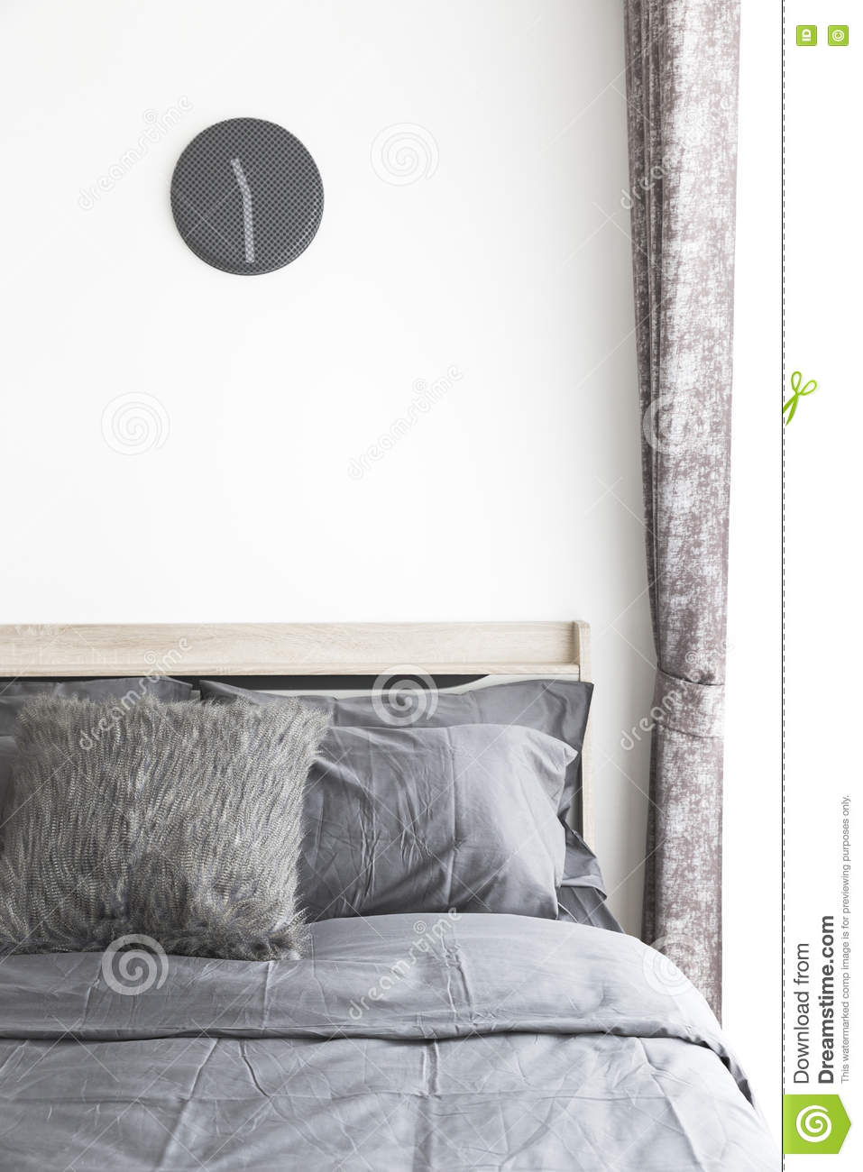 Grey pillows on bed