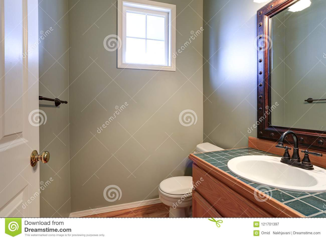 Grey Powder Room Offers Vanity Cabinet With Green Tiled Counter Top Stock Image Image Of Green House 121701397