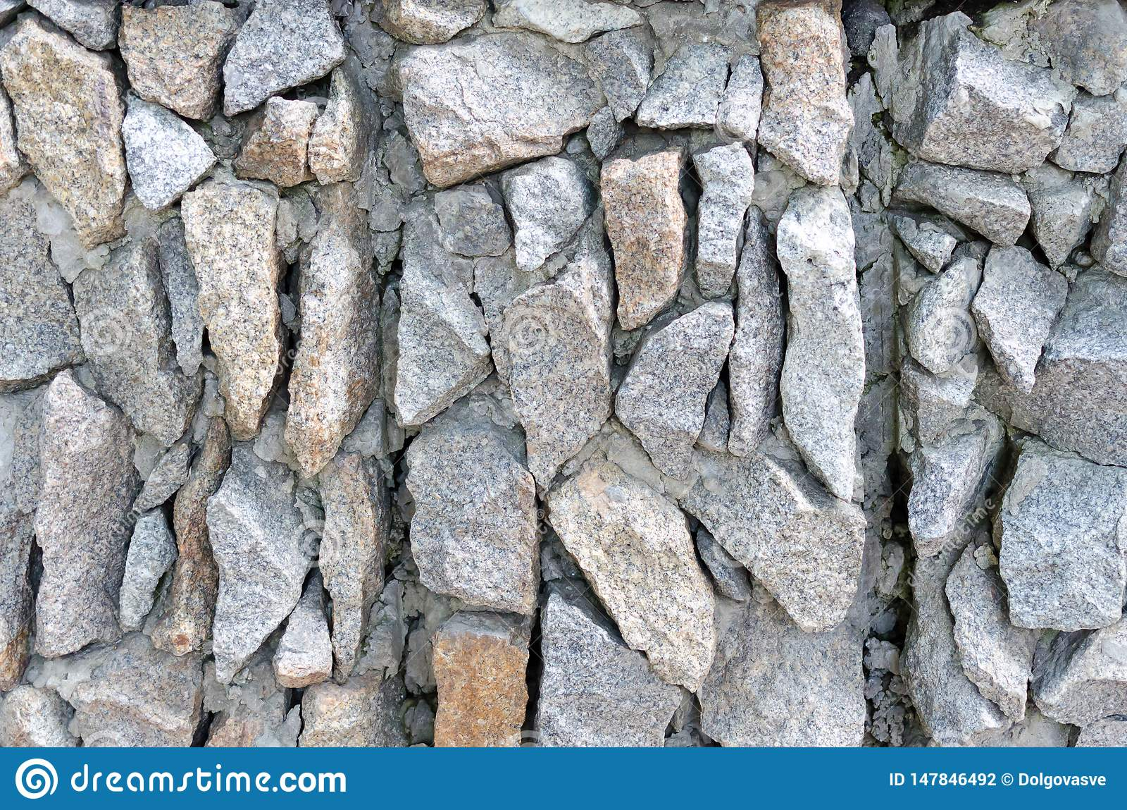 Grey rough stone masonry on facade Texture