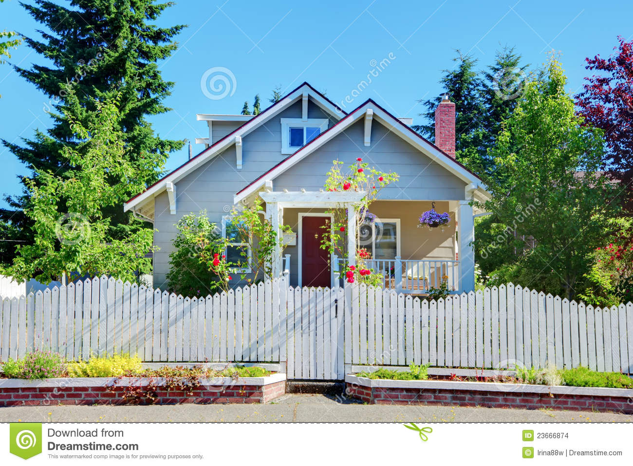 Grey Small Cute House With White Fence And Gates Stock
