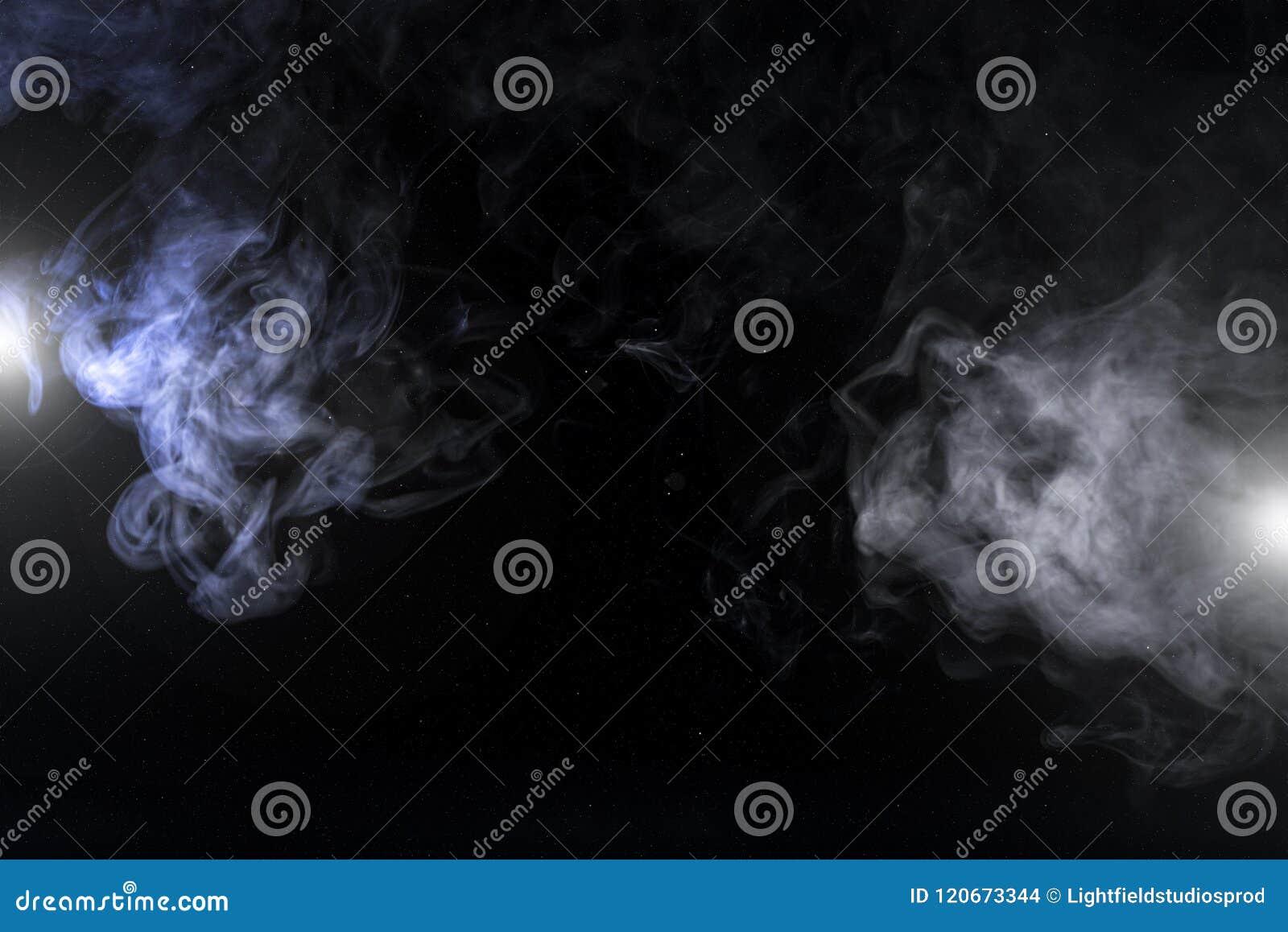 grey smoky swirls and lights on black background