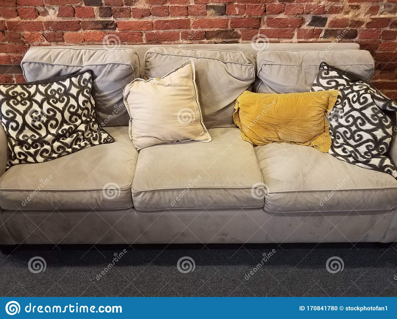 Grey Sofa Or Couch With Black And White And Yellow Pillows Stock Photo Image Of Pillow Yellow 170841780
