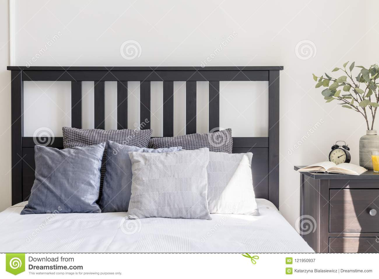 Grey And White Pillows On Bed With Black Headboard In Simple Bed Stock Image Image Of Wooden Apartment 121950937