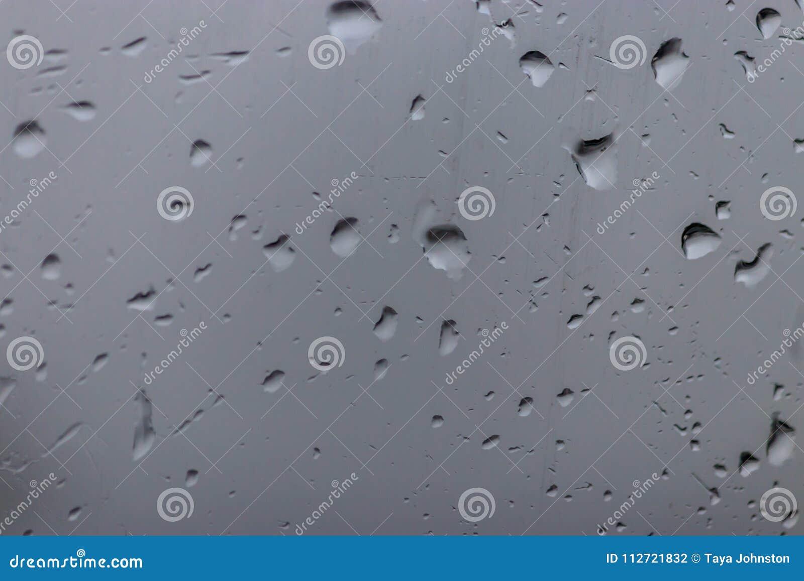 Grey window with rain