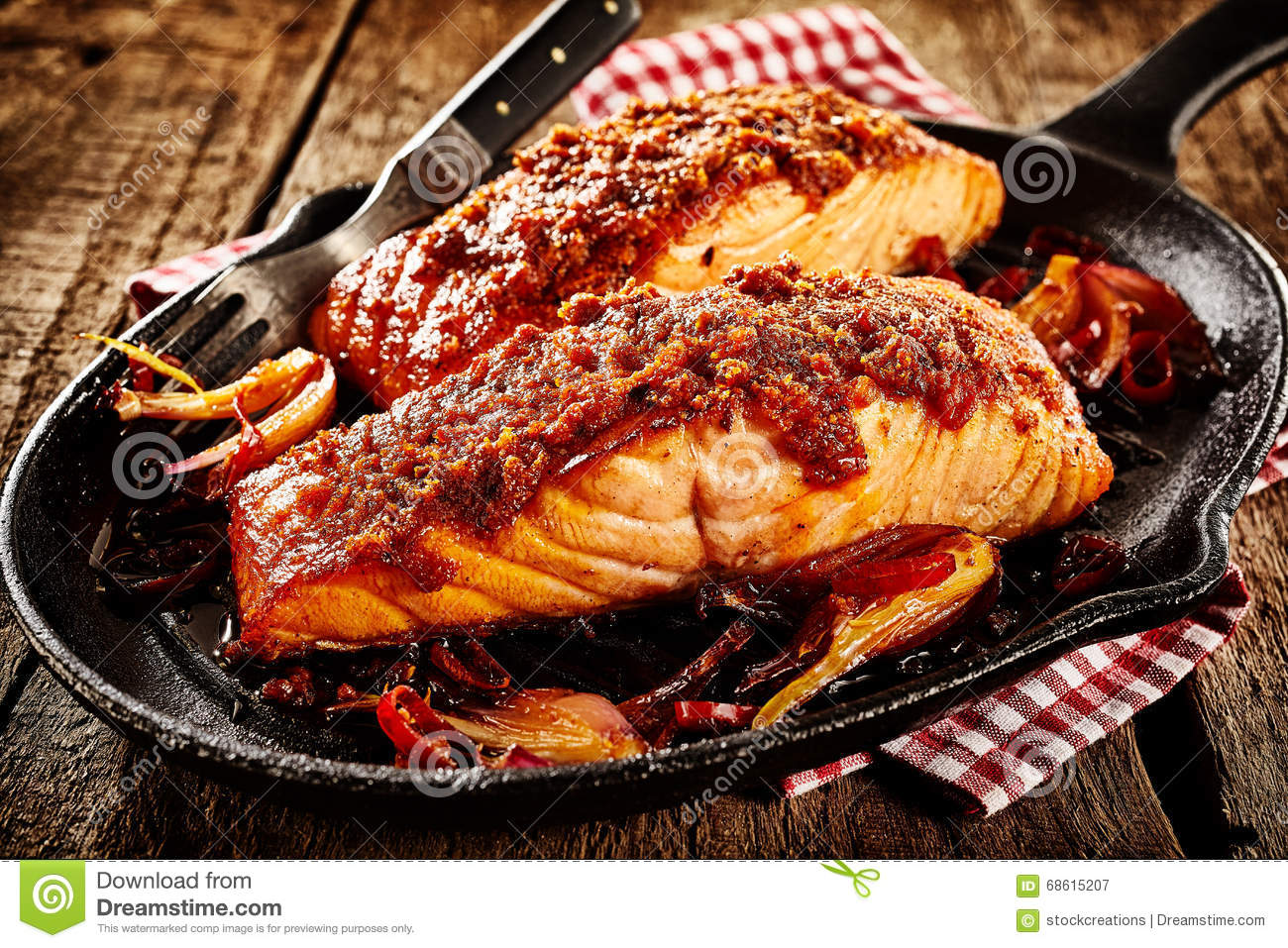 Griddle with mexican style baked fish and fork stock image for Baked fish seasoning