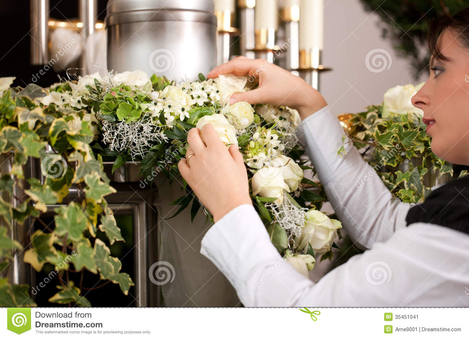 Grief - female mortician preparing urn Funeral
