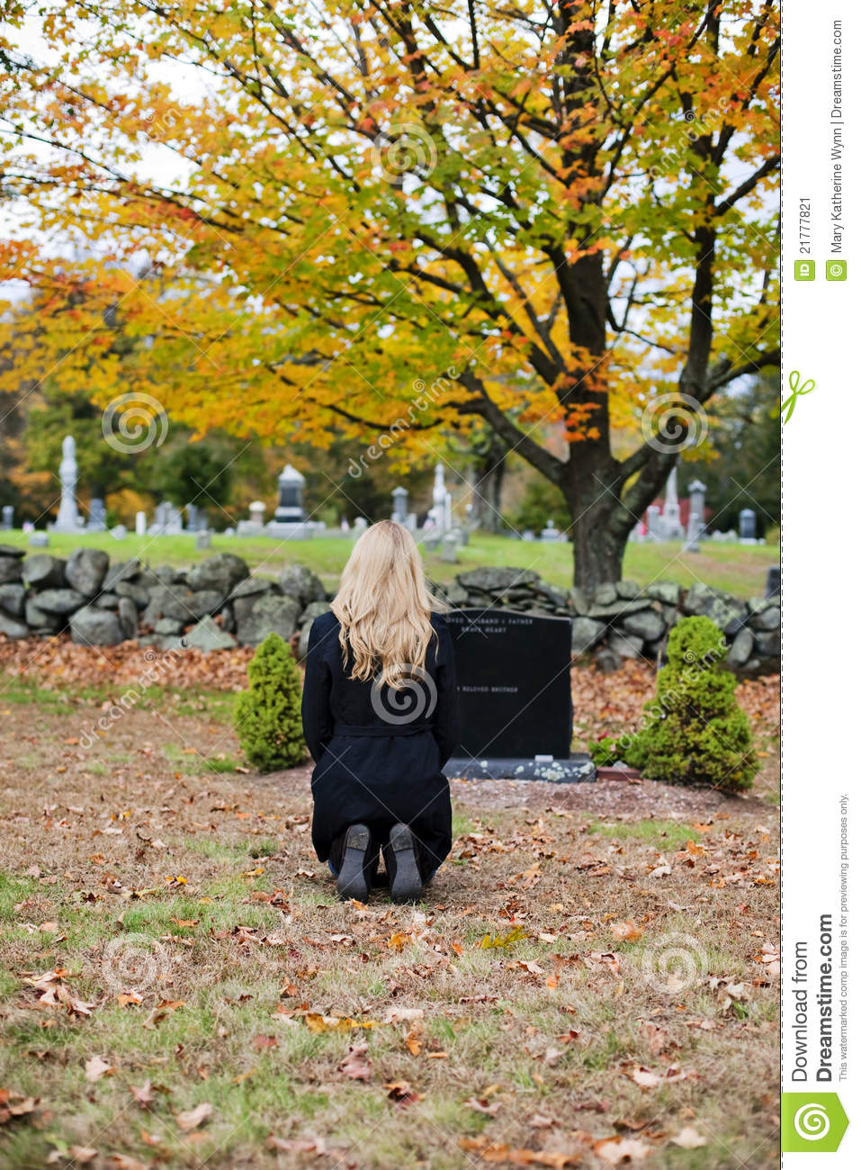 Grieving woman in cemetery