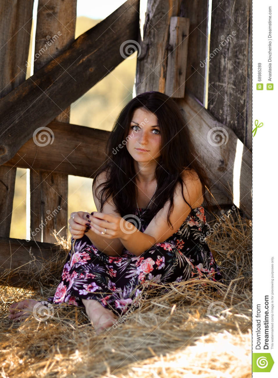 Relaxing serious calm brunette girl with blue eyes