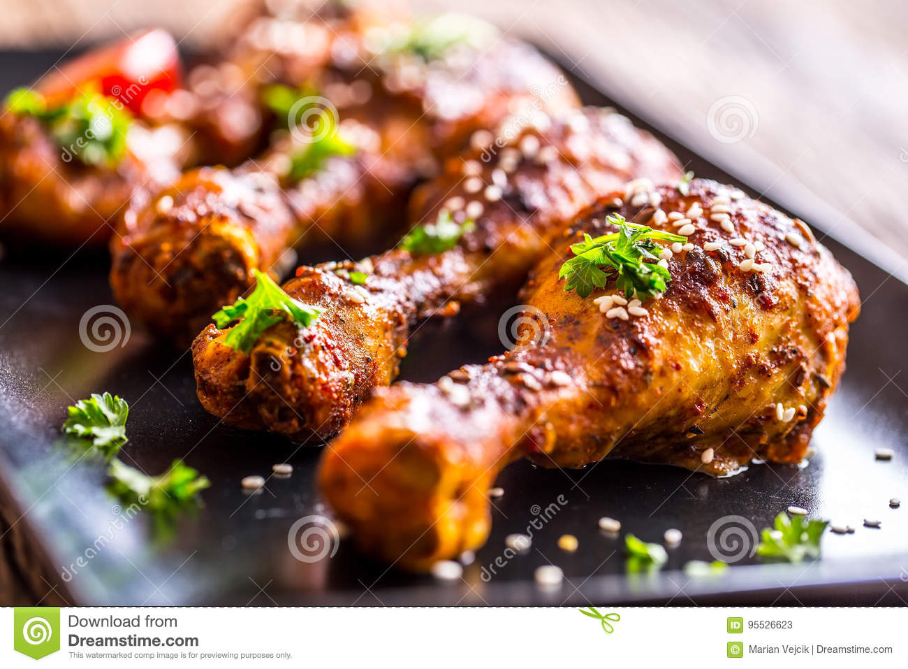 Grill chicken legs. Grilled chicken legs BBQ with sesame parsley and tomato