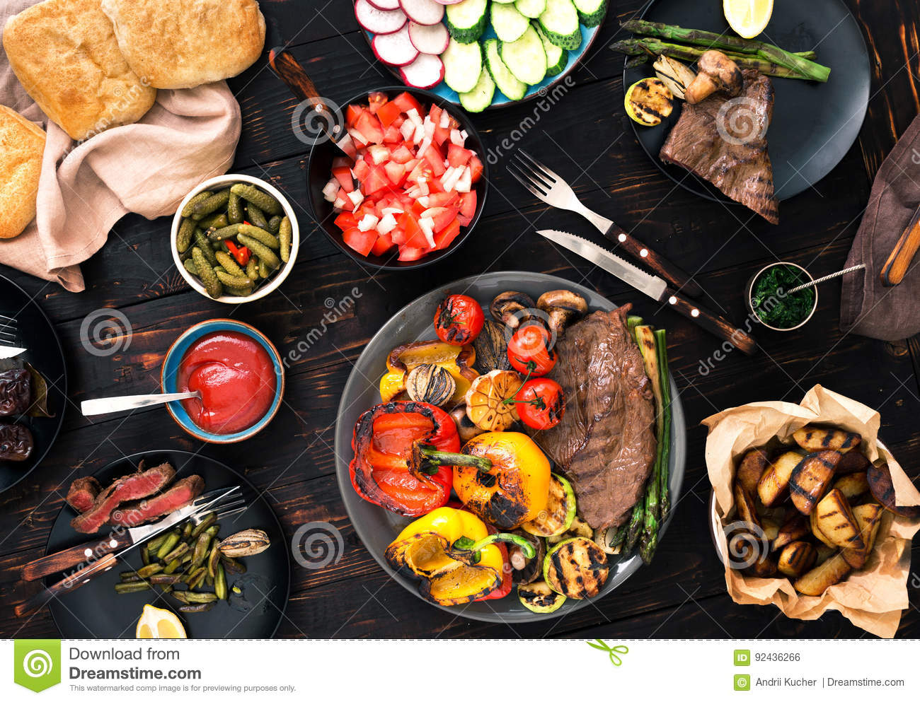 Grill steak and grilled vegetables on the wooden table
