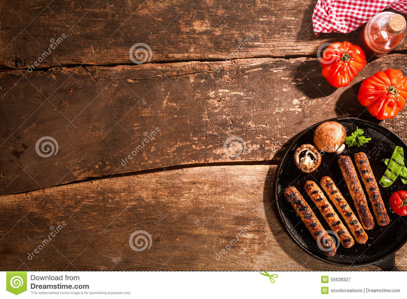 Grilled barbecued sausage with mushrooms