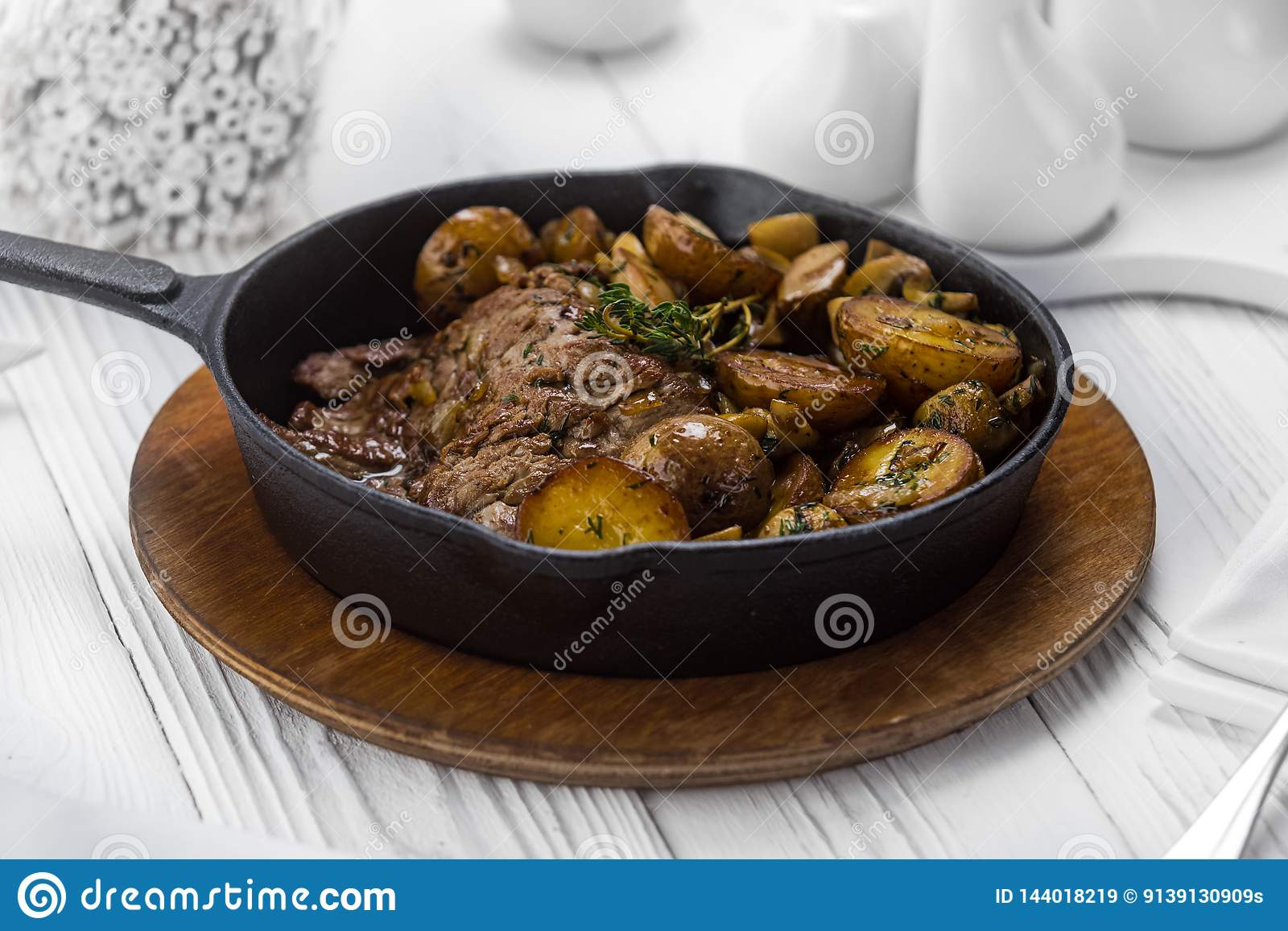 Grilled beef meat steak with fried potatoes