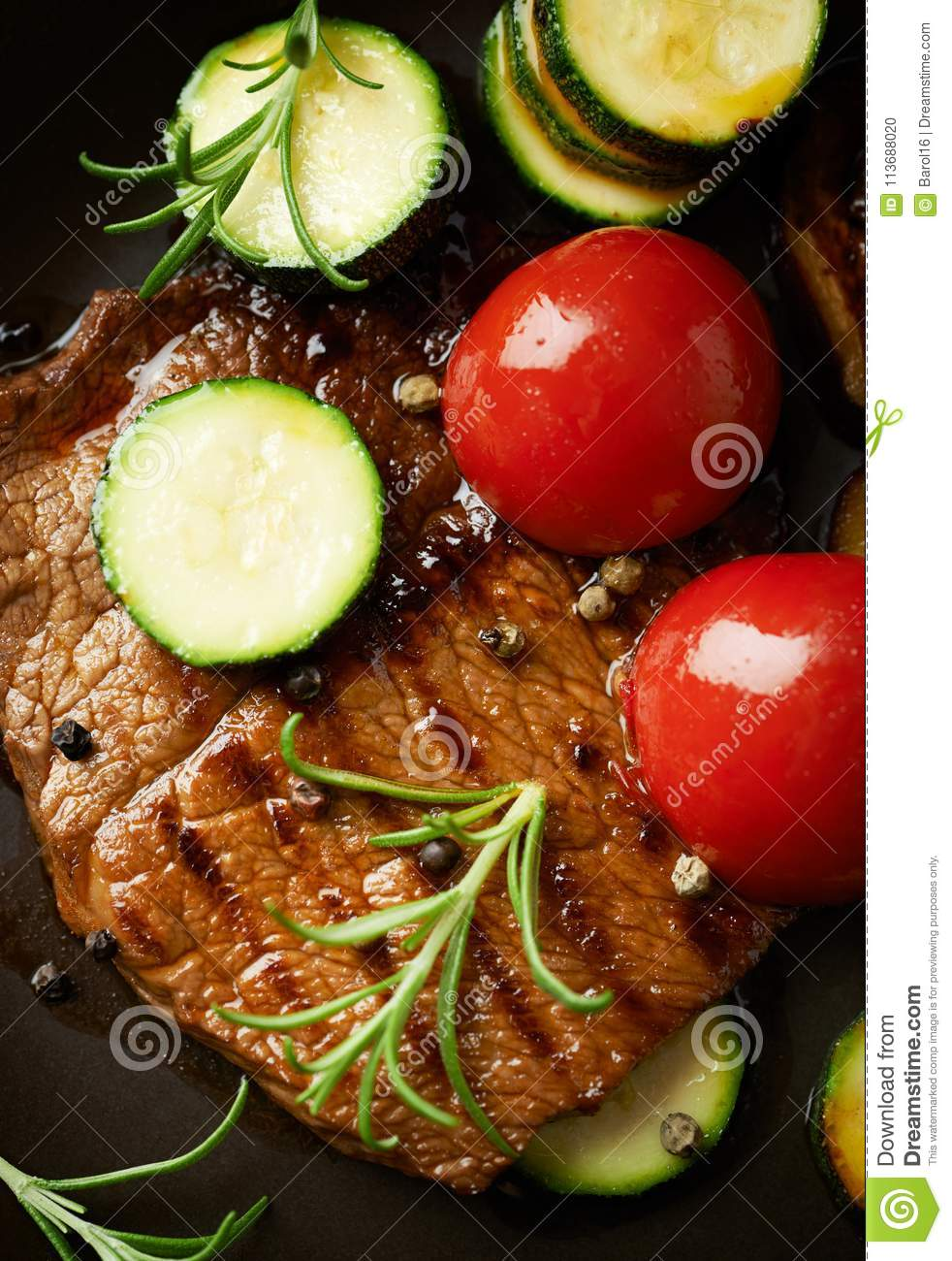 Grilled beef steak with vegetables . Top view.