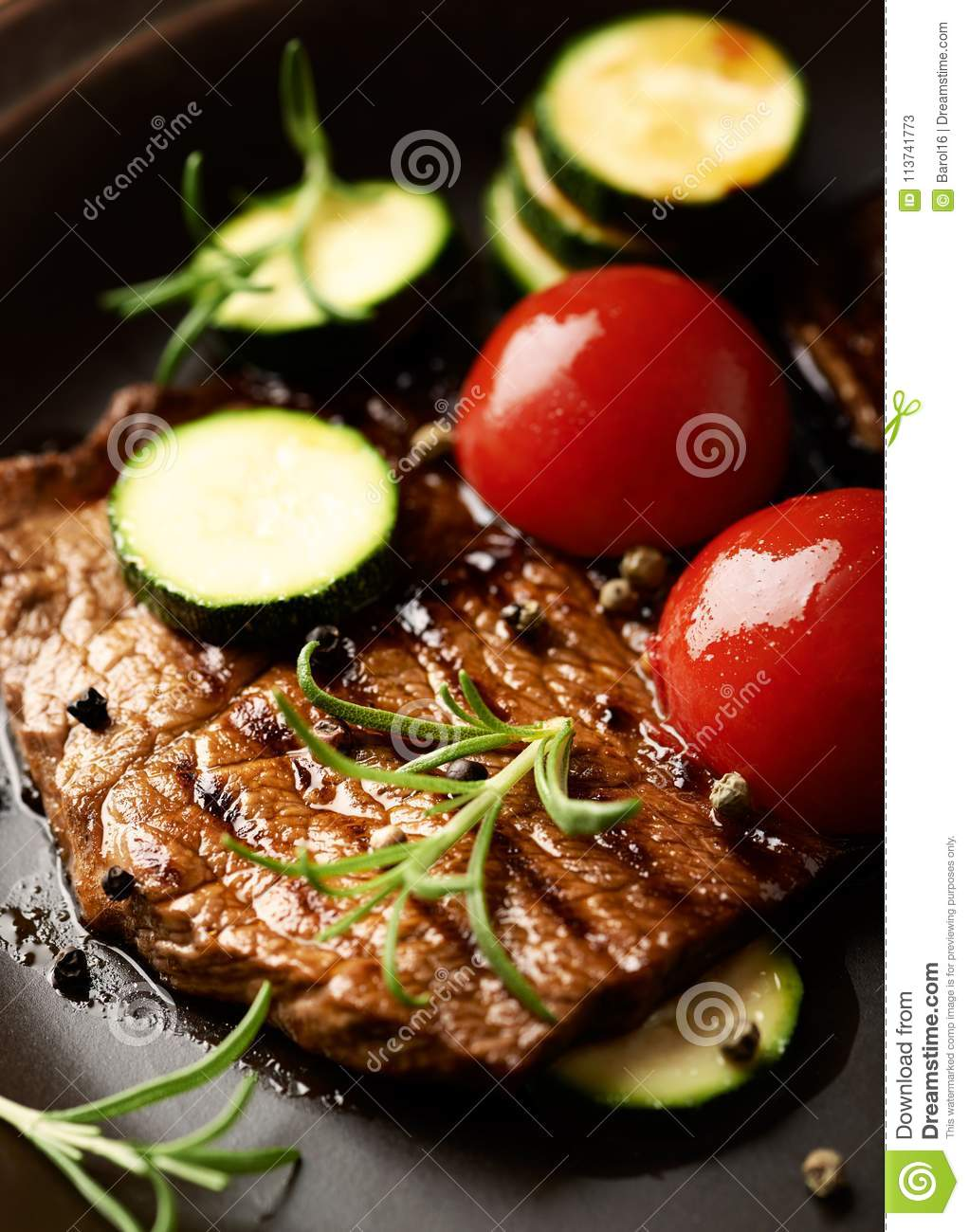 Grilled beef steak with vegetables .