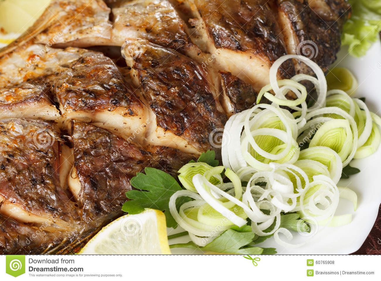 grilled carp fish with vegetables entirely traditional christmas meal - Traditional Christmas Meal