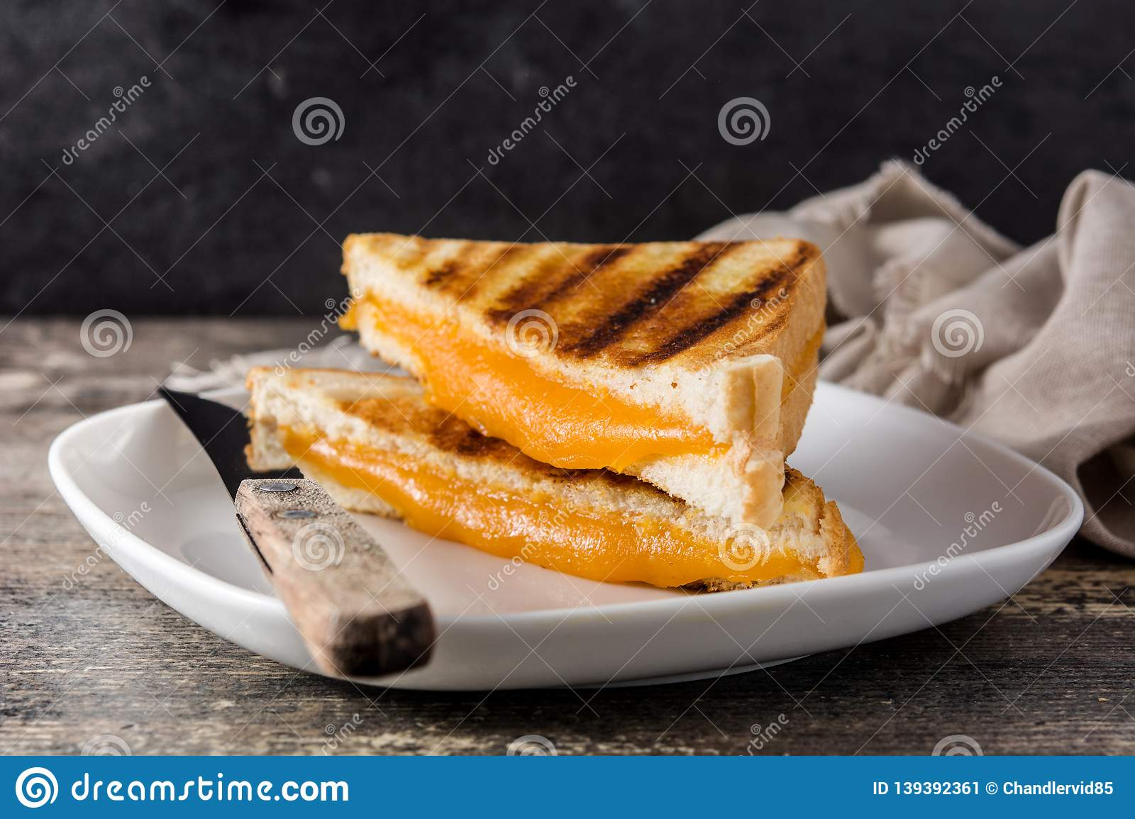 Grilled cheese sandwich on wood