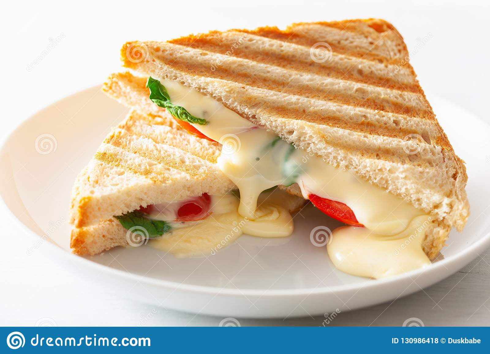 Grilled Cheese And Tomato Sandwich On White Background Stock Photo Image Of Crispy Appetizer 130986418