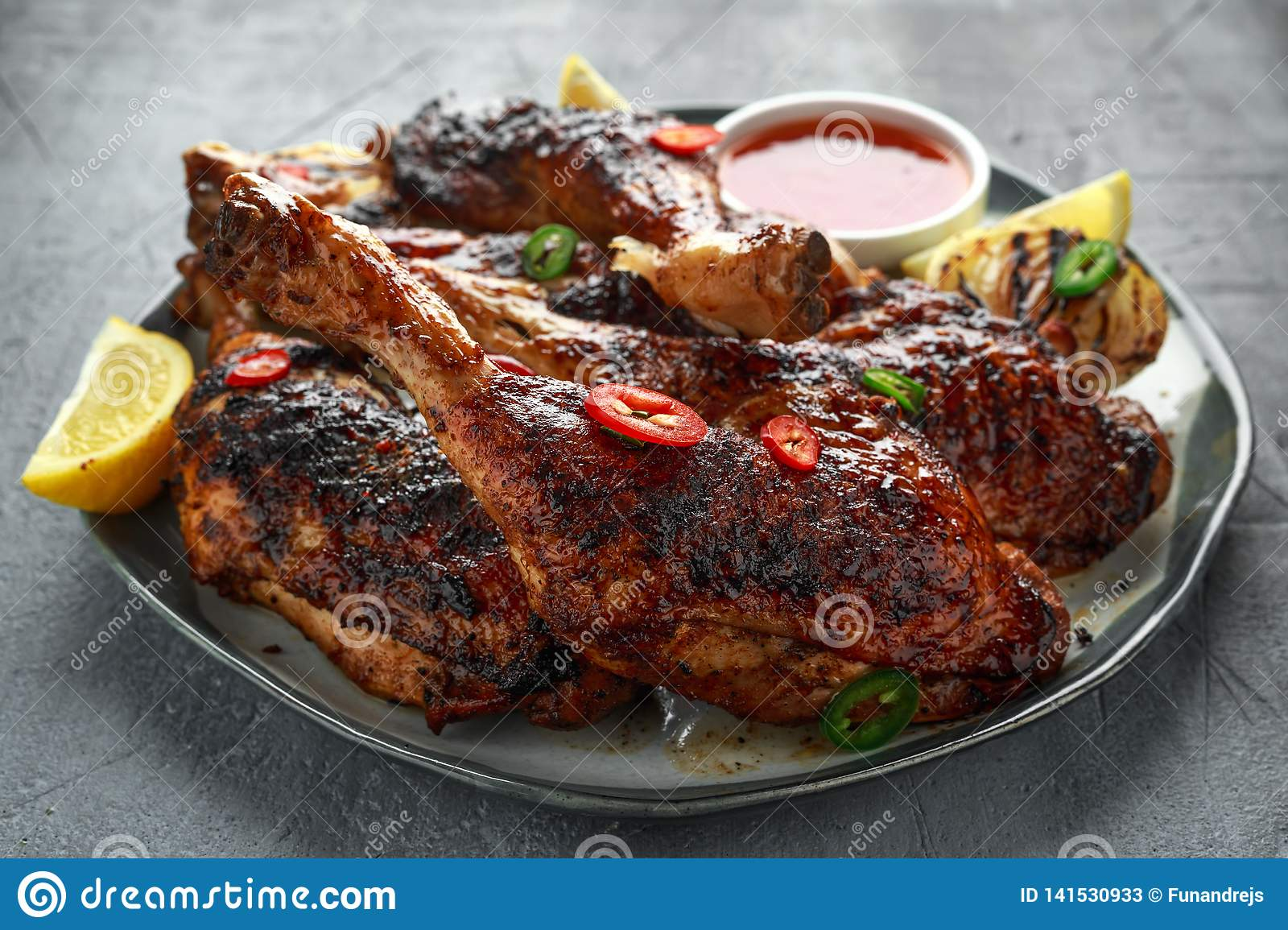 Grilled chicken legs with lemon and sweet chilli sauce