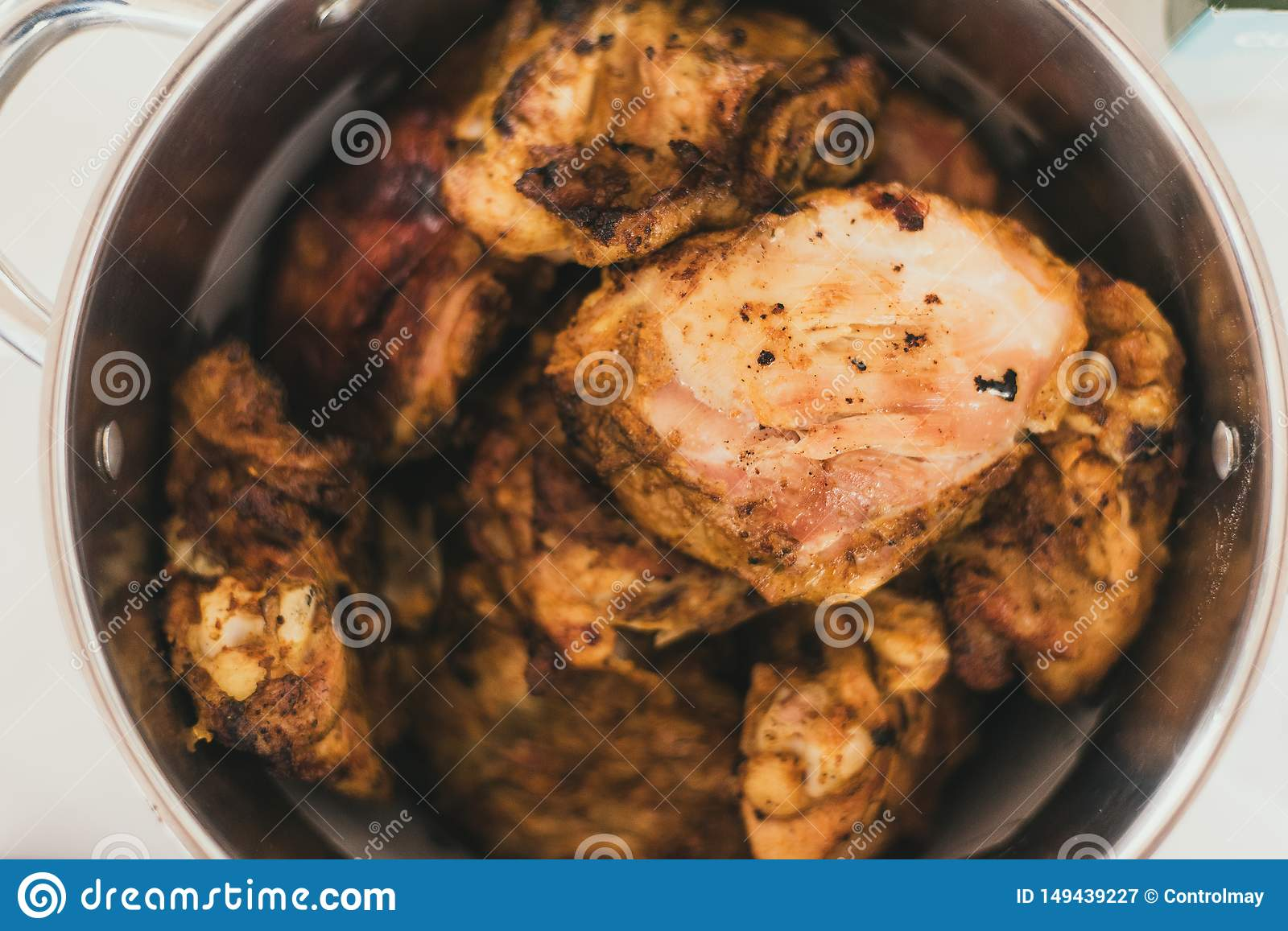 Grilled chicken in a saucepan. Chicken with a golden crust