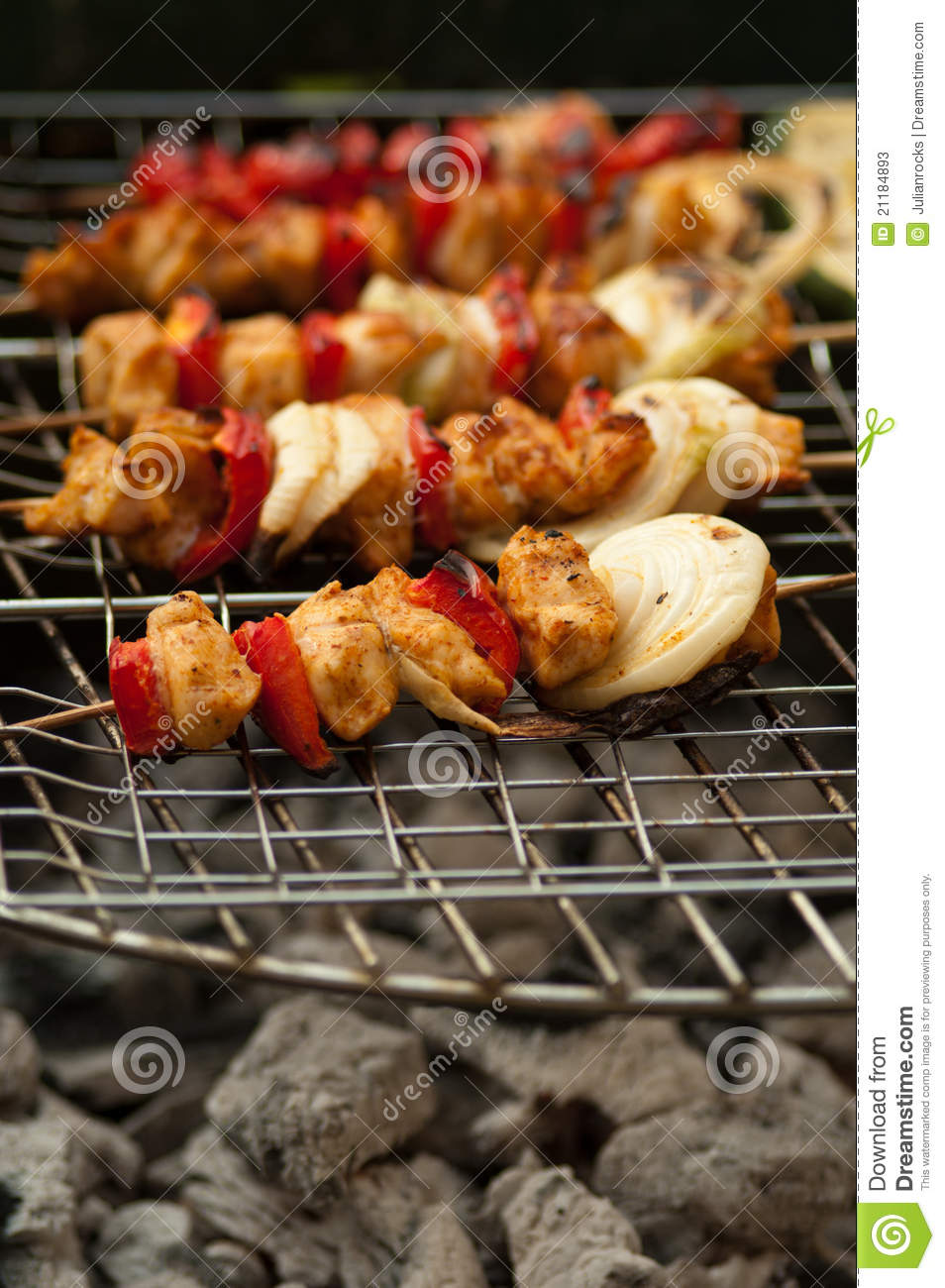 Grilled chicken on a stick with onion and pepper